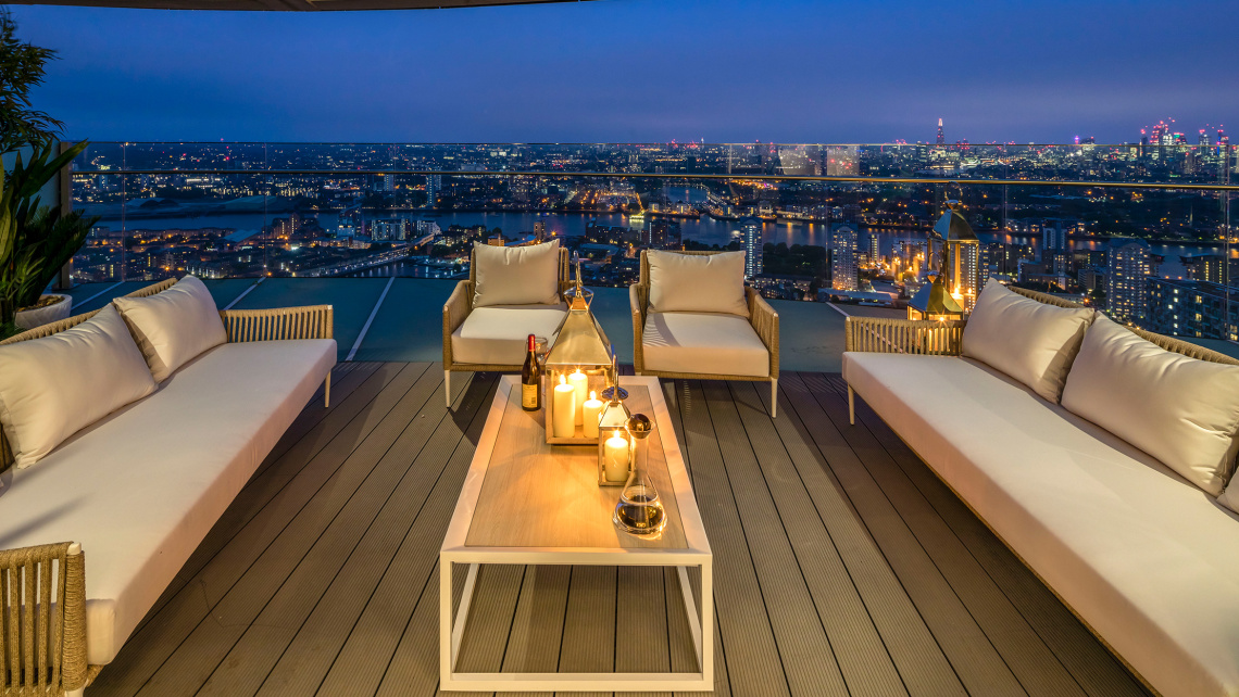 Penthouse private terrace at dusk with views of Canary Wharf, ©Galliard Homes.