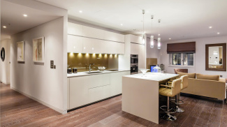 Kitchen and living room at a Marconi House show apartment, ©Galliard Homes.