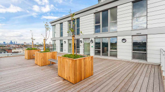 Communal roof terrace decking section at Distillery Crescent, ©Galliard Homes.