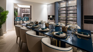 Penthouse dining area and wine display cabinet with access to the private terrace, ©Galliard Homes.