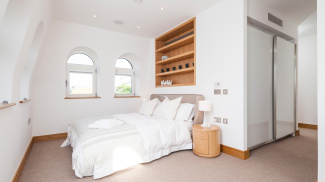 Bedroom at a Ludgate Broadway show apartment, ©Galliard Homes.