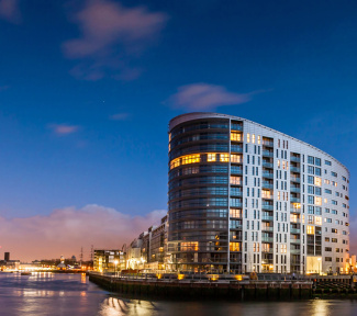 New Capital Quay exterior at night, ©Galliard Homes.