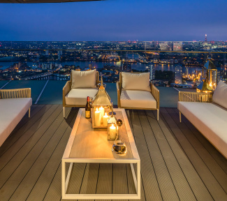Penthouse private terrace at dusk with views of Canary Wharf, ©Galliard Homes..