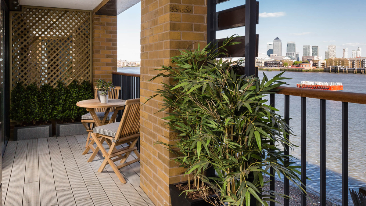 Balcony with views of the River Thames and Canary Wharf at the Wapping Riverside show apartment, ©Galliard Homes.