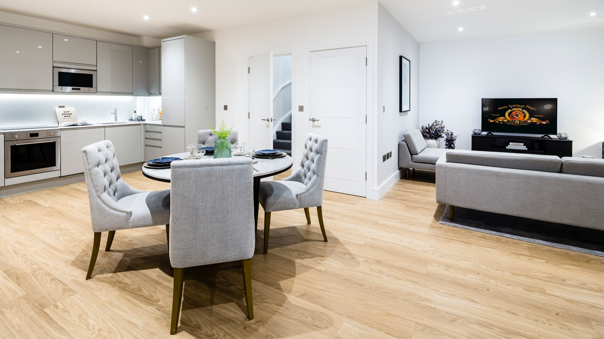 Open-plan kitchen, living and dining room at the Timber Yard show apartment, ©Galliard Homes.