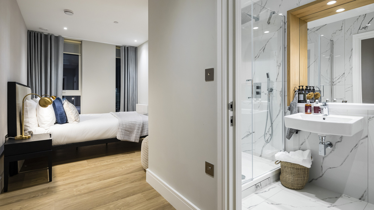 Bedroom with en-suite shower room at a Wimbledon Grounds apartment, ©Galliard Homes
