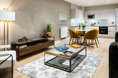 Open-plan kitchen and living area at a Wimbledon Grounds apartment, ©Galliard Homes.